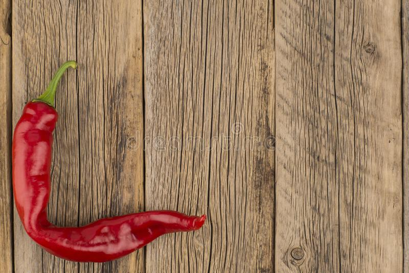 Red chilli pepper on wood background. stock photo
