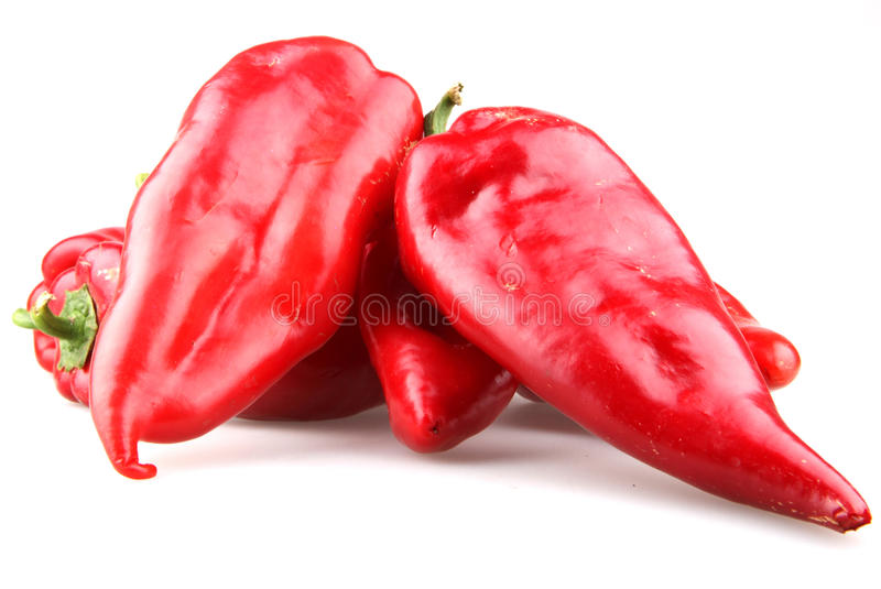 Red chilli peppers. On white background stock image