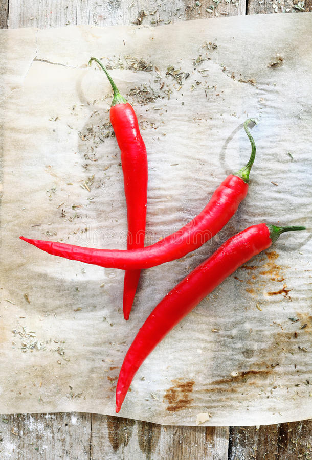 Free Red Chilli Peppers On Grunge Paper Stock Photography - 26525722