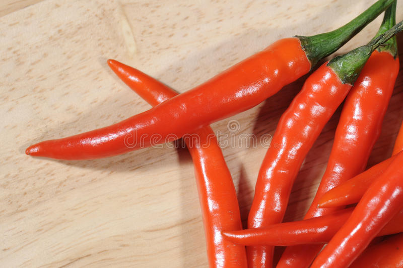 Red chillies on butcher royalty free stock photo