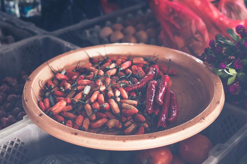 Red Chillis on Brown Wooden Tray royalty free stock images