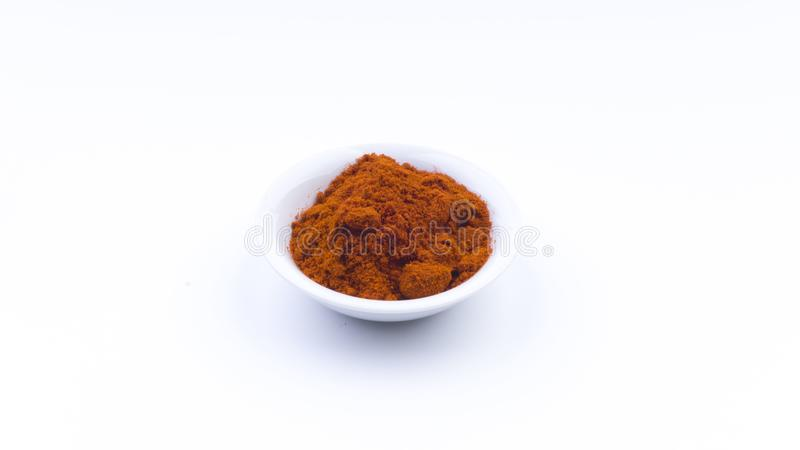 Red Chilly Powder in a bowl on white background.Selective focus and crop fragment. royalty free stock images