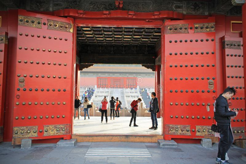Red Chinese door in Forbidden city, Beijing, China. The people can go through the red massive door royalty free stock photography