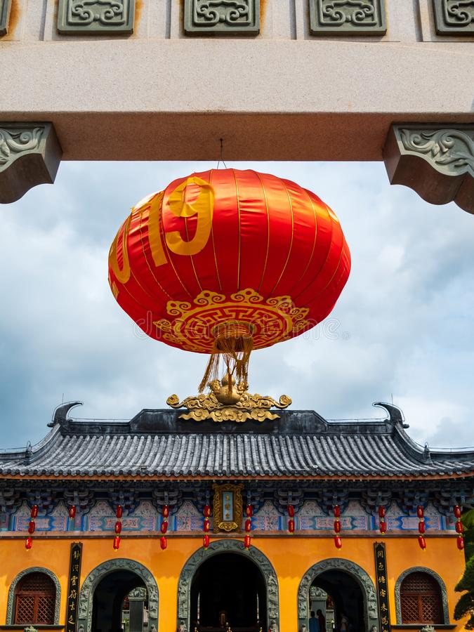 Red Chinese lantern hanging at the doorway of a Chinese Taoist temple. In Hainan, China stock images