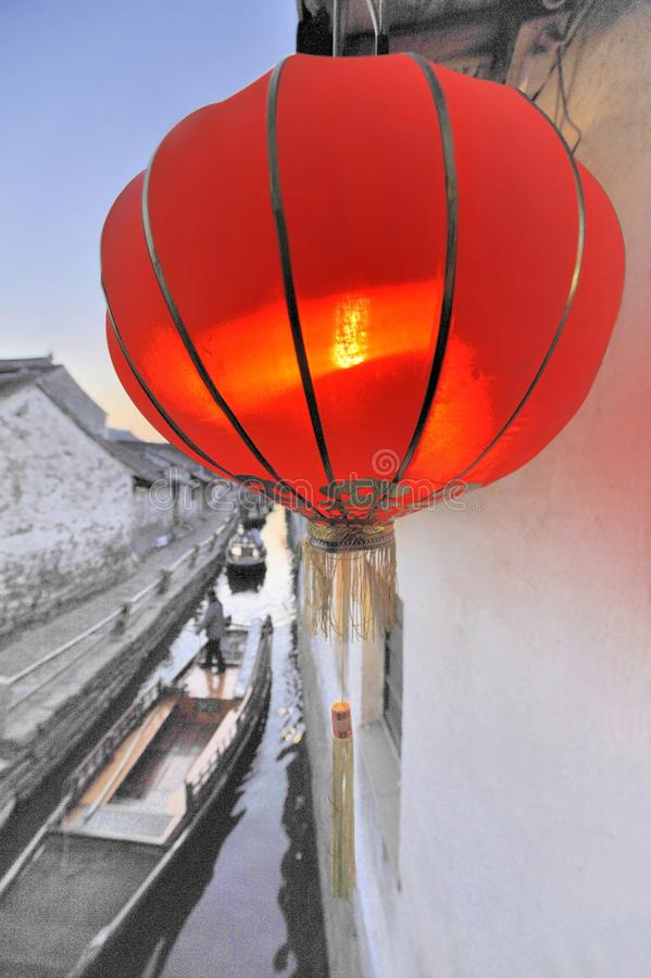 Red Chinese Lantern in Zhou Zhuang. Red Chinese Lantern alongside a canal with boats in Zhou Zhuang, China royalty free stock photo