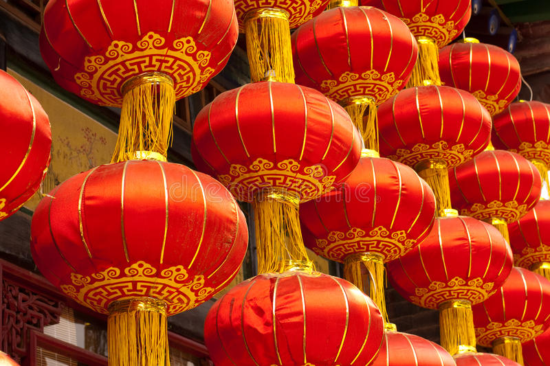 Red Chinese lanterns. Hanging from a traditional Chinese house in Pingyao stock image