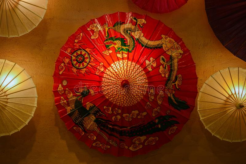 Red Chinese oil paper umbrella with dragon and pheonix drawings o stock photos