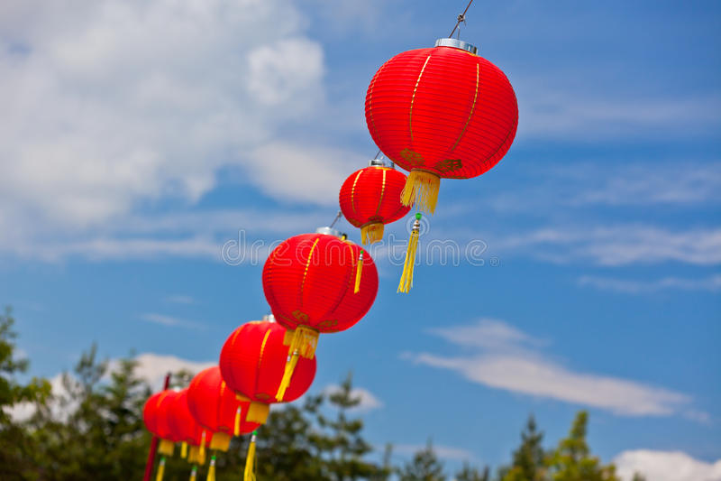 Download Red Chinese Paper Lanterns Against A Blue Sky Stock Photo - Image of lanterns, decor: 35869922