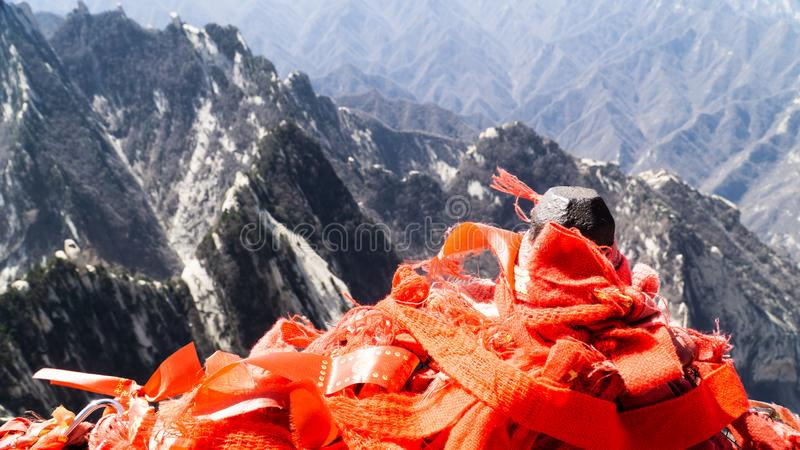 Red chinese ribbons placed on the top of North Peak - one of five main peaks belonging to sacred taoist mountain Mount Huashan, po. Pular touristic place stock photography