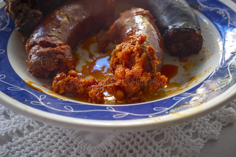 Red chorizo and black sausage morcilla just boiled on a plate over knitting cloth. Closeup stock photography