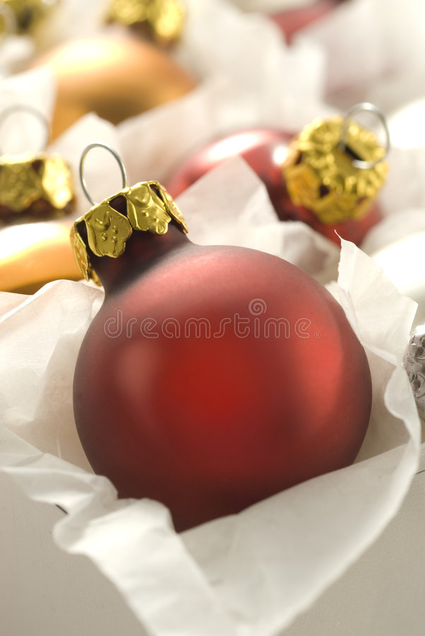 Red christmas ball in box royalty free stock photography