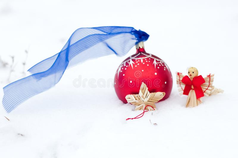Christmas ball and star and angel on snow royalty free stock images