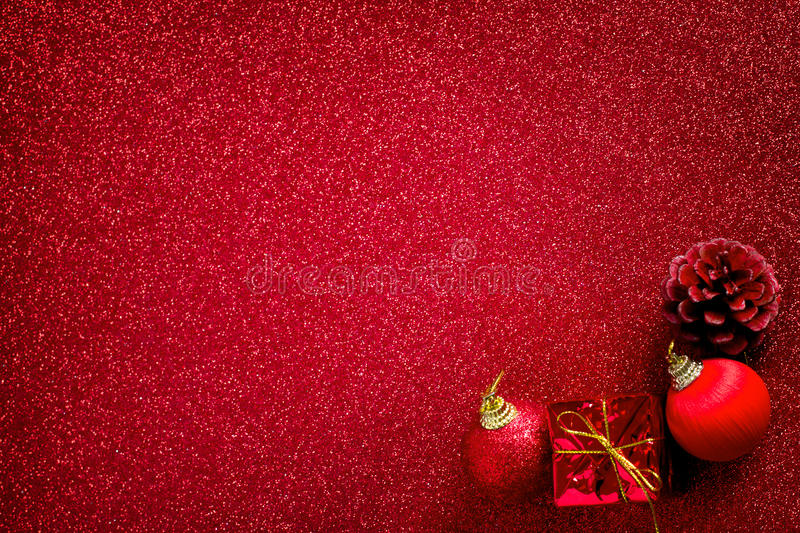 Red christmas ball and gift decoration glitter background. Red christmas ball and gift decoration on the glitter background stock photos