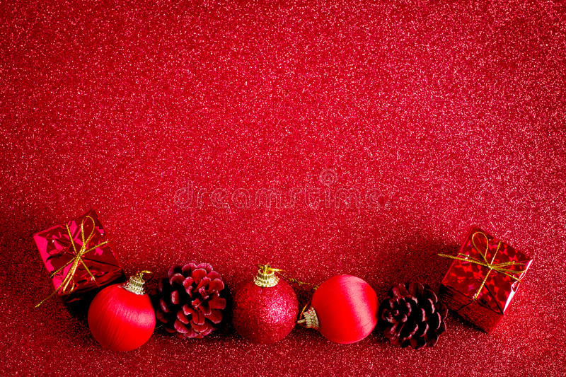 Red christmas ball and gift decoration glitter background. Red christmas ball and gift decoration on the glitter background royalty free stock images