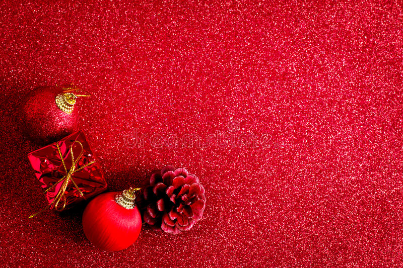 Red christmas ball and gift decoration glitter background. Red christmas ball and gift decoration on the glitter background stock photo