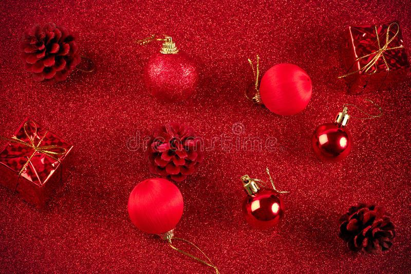 Red christmas ball and gift decoration glitter background. Red christmas ball and gift decoration on the glitter background stock photography