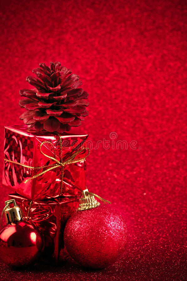 Red christmas ball and gift decoration glitter background. Red christmas ball and gift decoration on the glitter background royalty free stock photography
