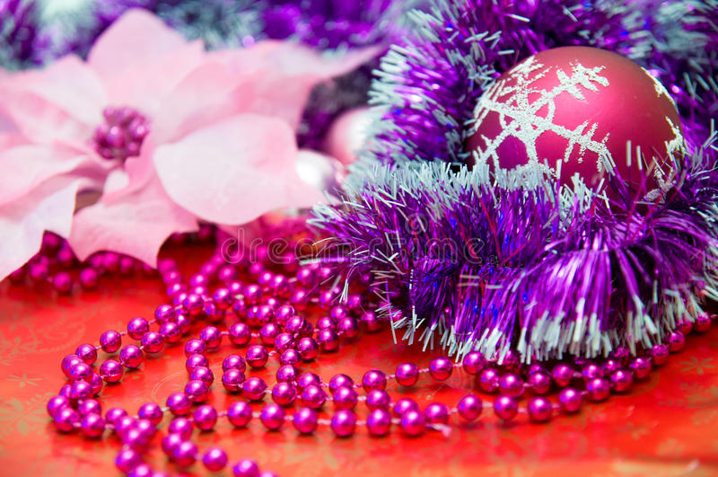Red Christmas Ball and other Purple Christmas-Tree Decorations stock photography