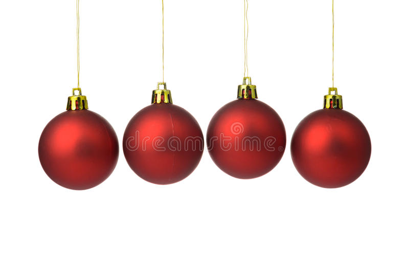Red Christmas balls. Hanging on string over white background royalty free stock photography