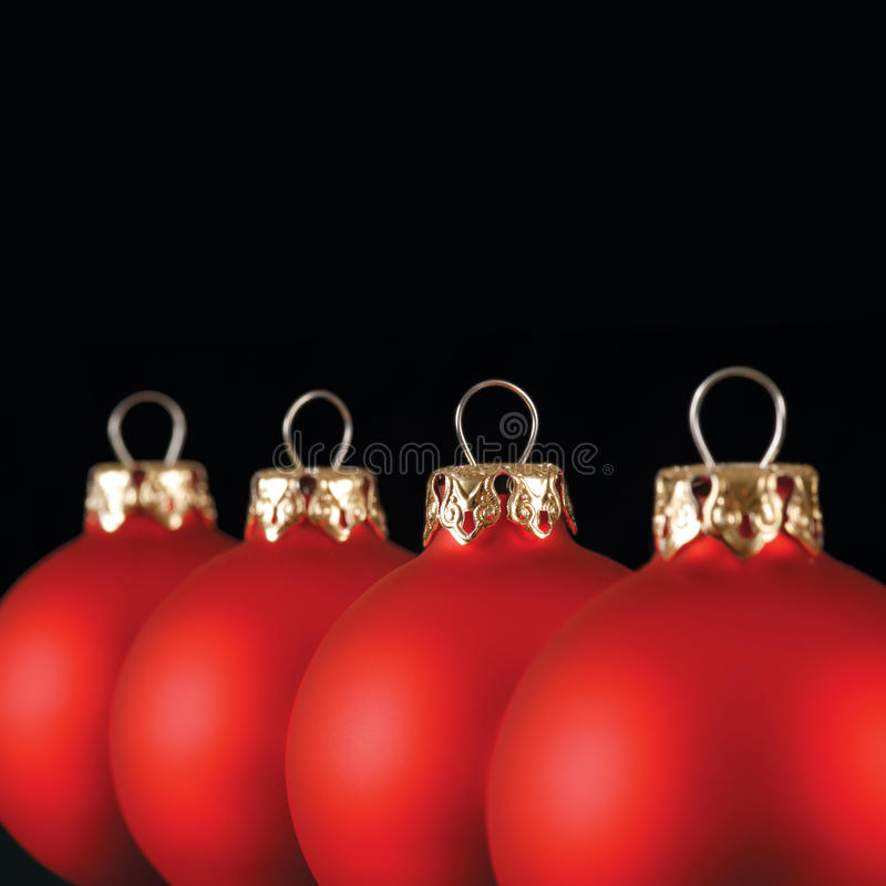 Red Christmas balls in a row royalty free stock photo