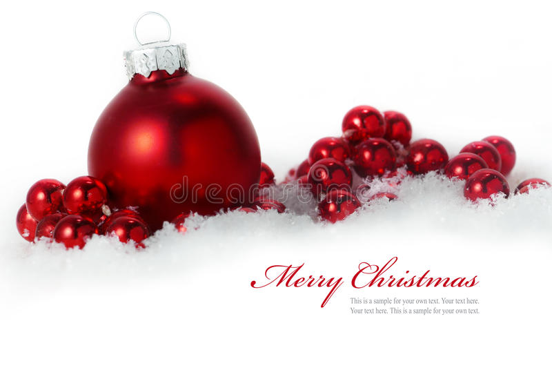 Red christmas balls in snow isolated on white background, sampl royalty free stock photos