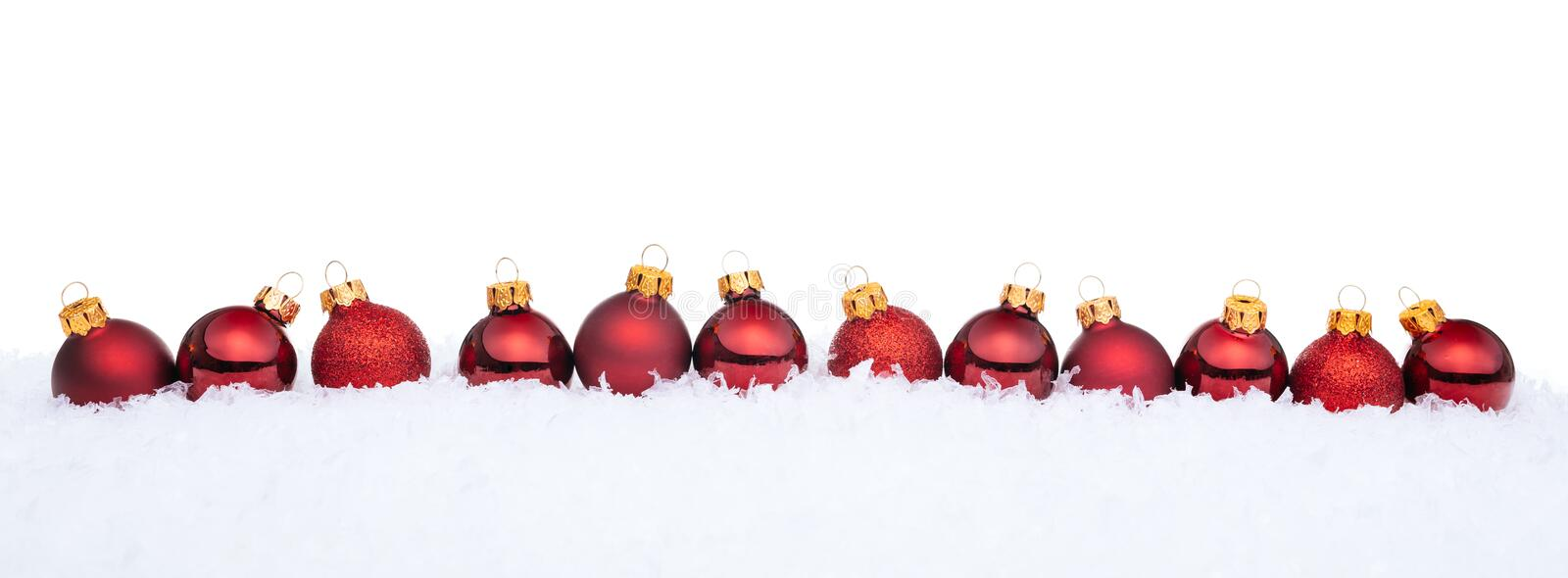 Red Christmas balls on snow. Christmas background royalty free stock image