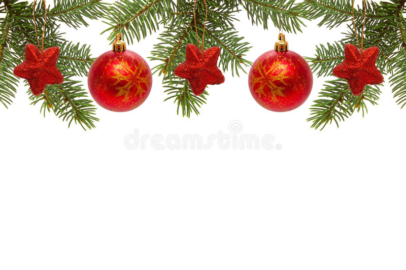 Red Christmas balls and stars. Red Christmas balls and green fir branches isolated on white background royalty free stock photo