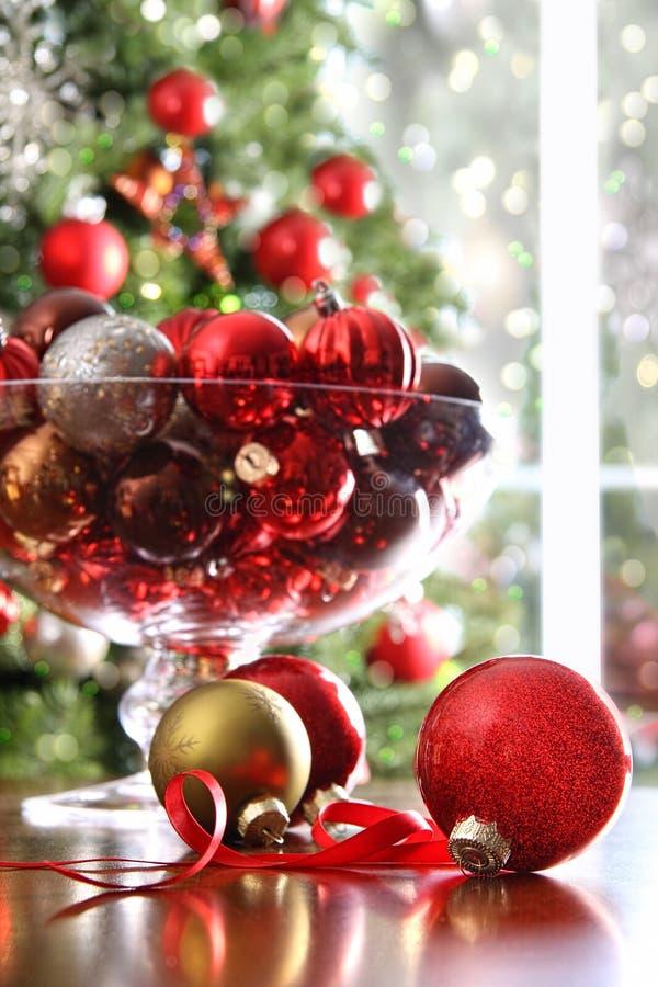 Red Christmas balls on table stock image