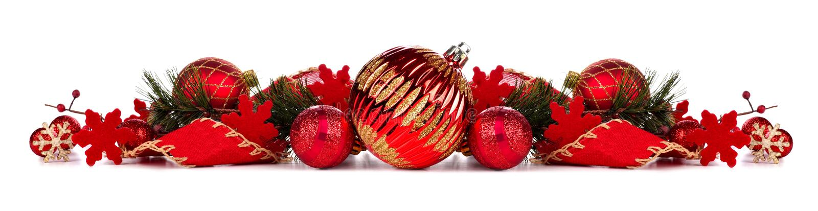 Red Christmas bauble border isolated on white. Christmas border with red baubles, ribbon and branches isolated on a white background stock images