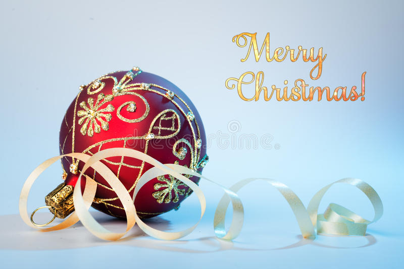 Red Christmas bauble on neutral background, text stock photography