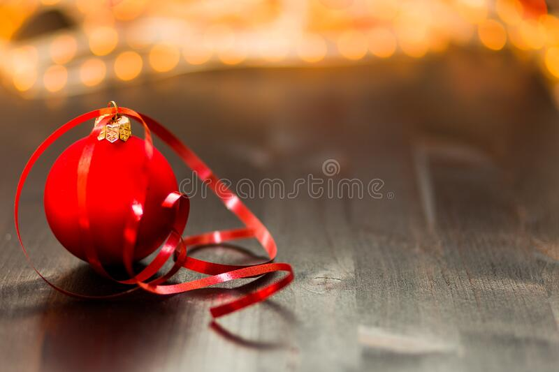 Red Christmas Bauble With Red Ribbon on Wooden Surface in Close Up Photography royalty free stock images