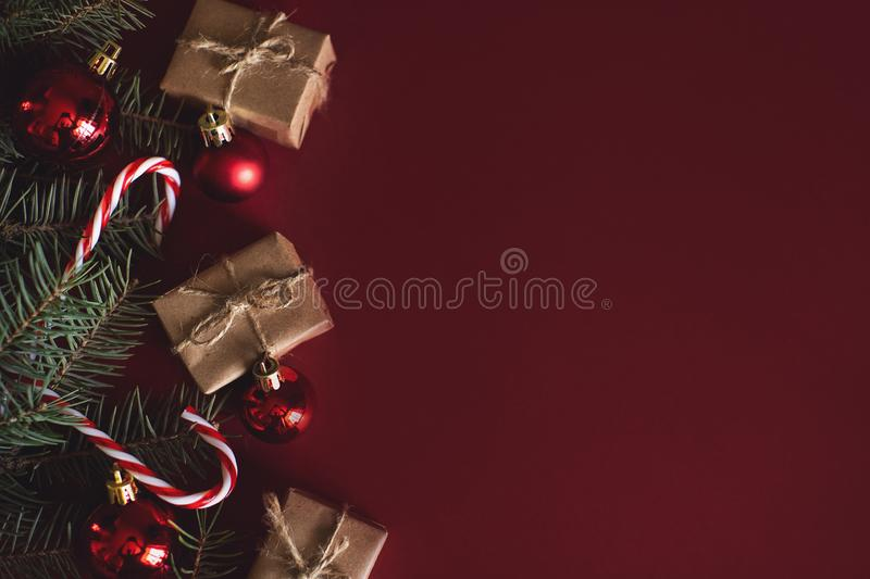 Red Christmas baubles decoration on red background with copy space. New Year greeting card. Minimal style. Flat lay.  stock photography