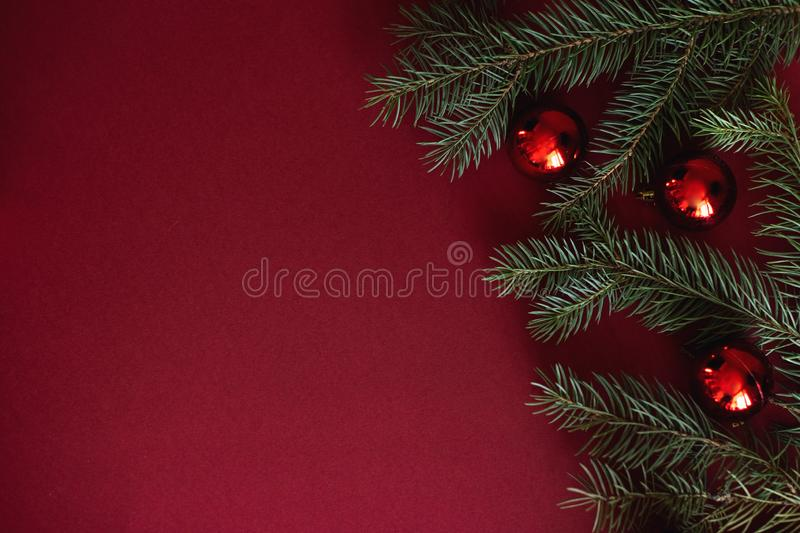 Red Christmas baubles decoration on red background with copy space. New Year greeting card. Minimal style. Flat lay.  royalty free stock photography