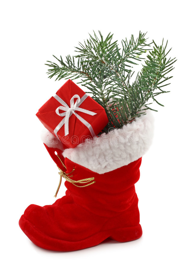 Red Christmas boot. With gift isolated on white background stock photography