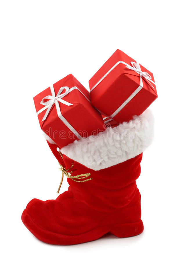 Red Christmas boot. With gifts isolated on white background royalty free stock photo