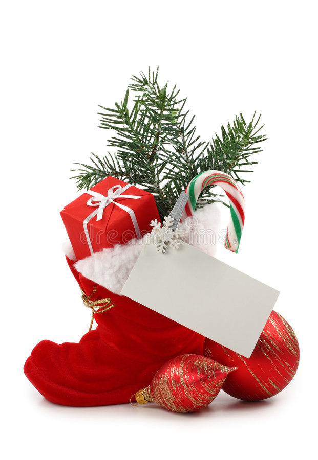 Red Christmas boot with gift. Isolated on white background stock photography