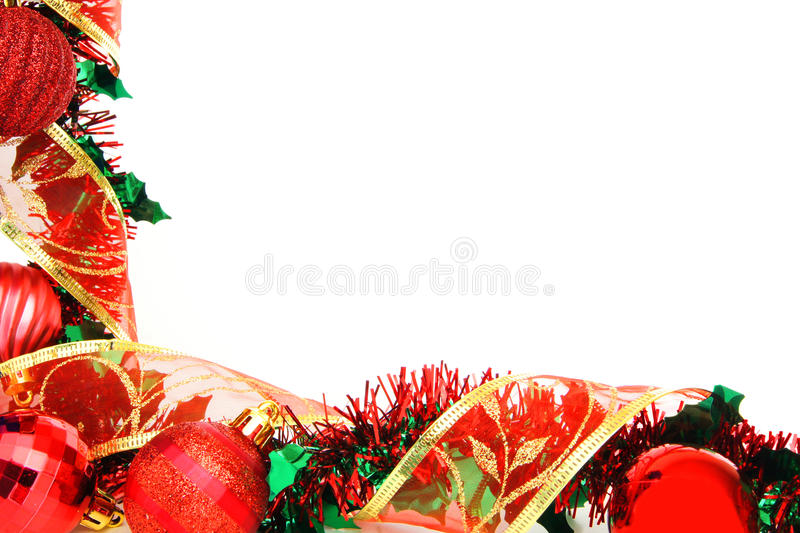 Red Christmas border. With baubles, garland and shiny ribbon over white royalty free stock images