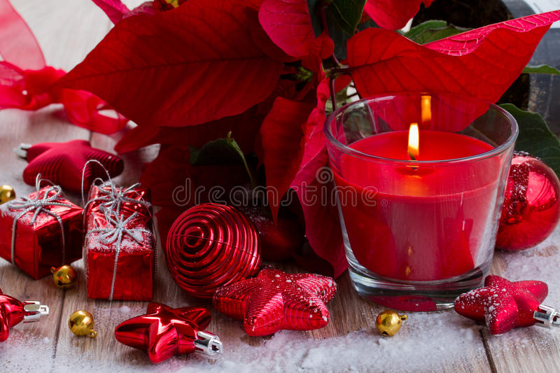 Red christmas candle with decorations