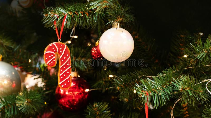 Red christmas cane cookie decorated with sweet white sugar icing. Festive background backdrop postcard wallpaper New Year royalty free stock photo