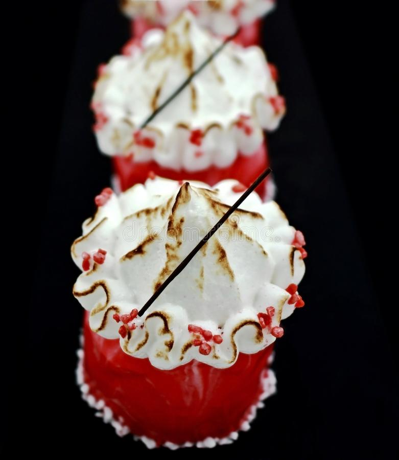 Red Christmas carousel design desserts with meringue topping stock photos