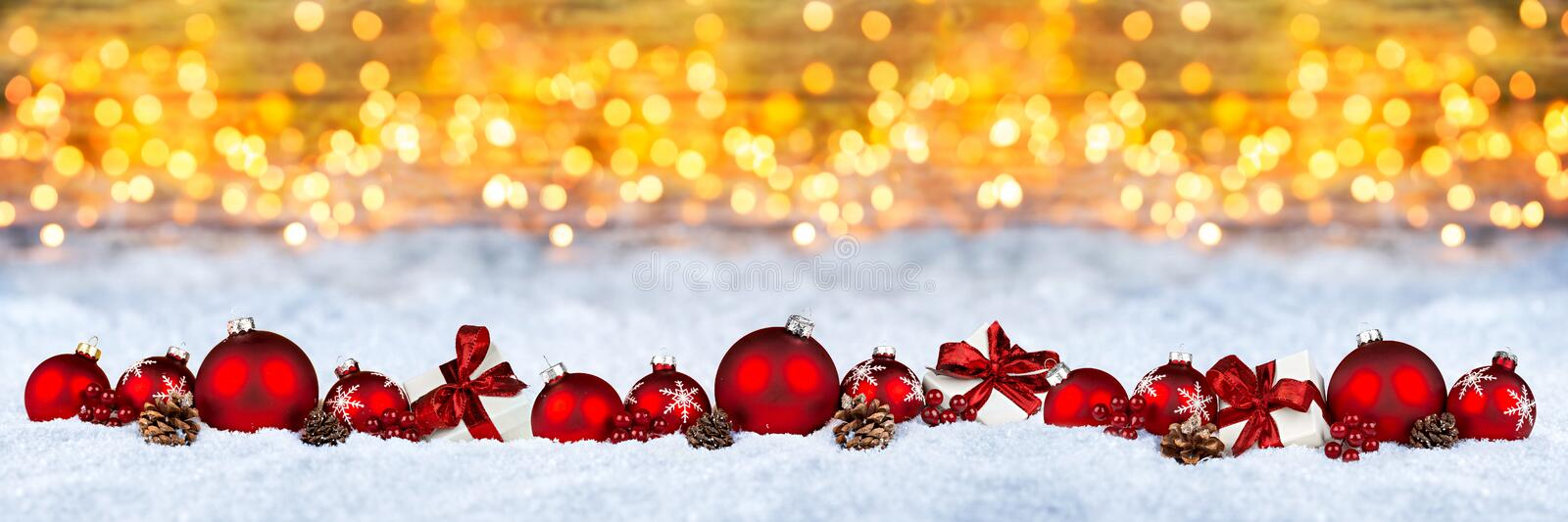 Red christmas decoration snow golden bokeh background royalty free stock photo