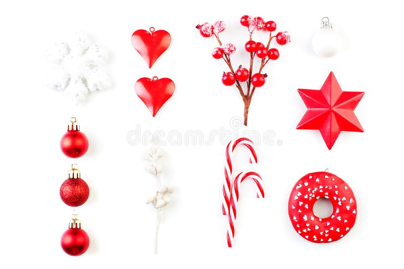 Red Christmas decorations isolated on white. Red holly berries, snowflake, glass baubles on white background, top view royalty free stock photography