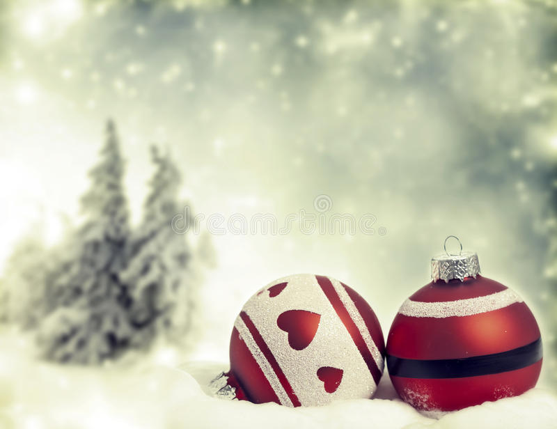 Red Christmas decorations in the snow stock images