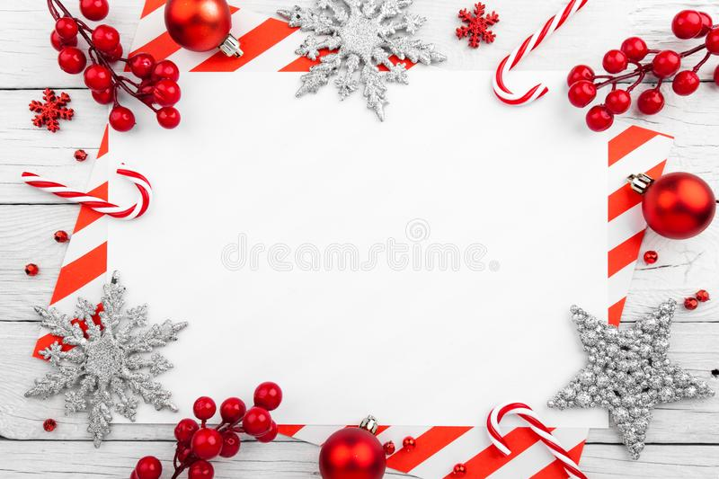 Red christmas frame with stars, snowflakes and candies. New Year Card stock photography