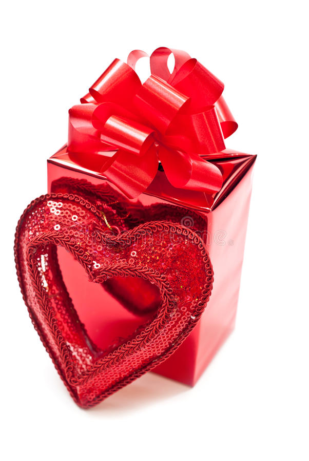 Red christmas gift. Red present and christmas heart with soft shadow. White background royalty free stock photos