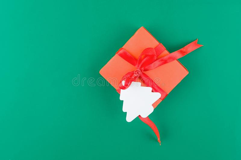 Red Christmas Gift box on a green background. Christmas or New Year background whits Red Gift box on green background. Christmas holiday concept. Flat lay, top stock image