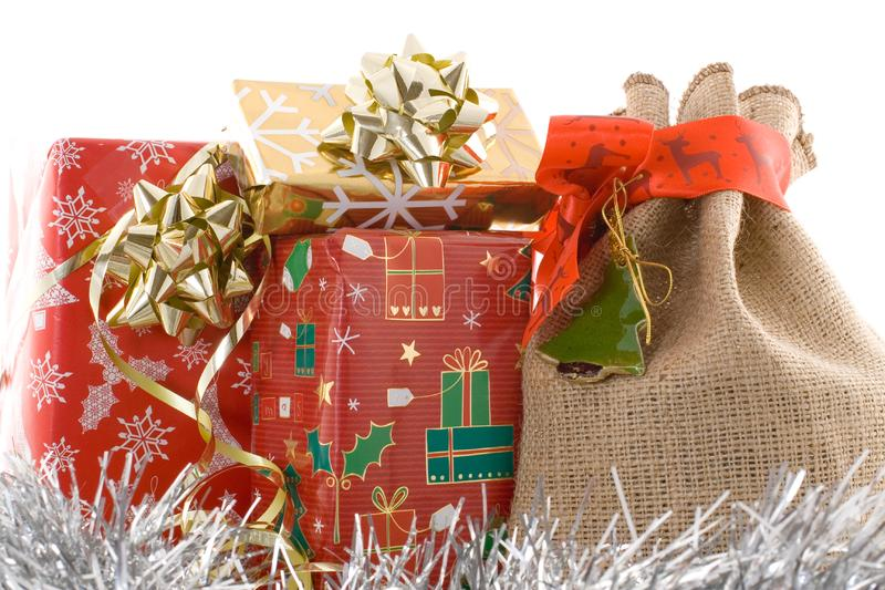 Red christmas gift with jute bag royalty free stock photography