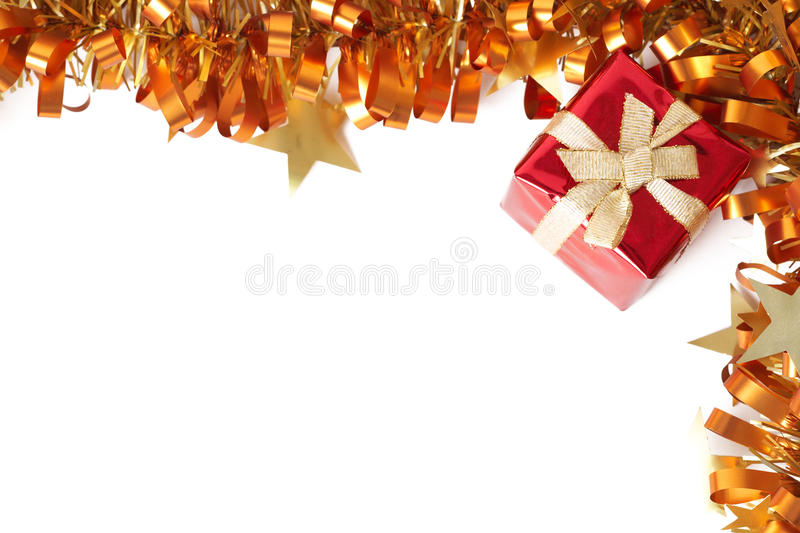 Red Christmas gift with tinsel frame stock image