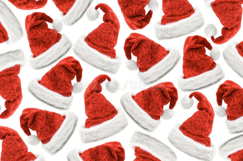 Red christmas hats flatlay isolated royalty free stock image