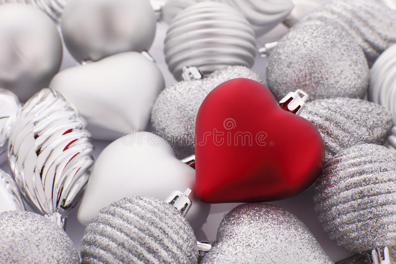 Red Christmas Heart. On Silver Bauble stock image